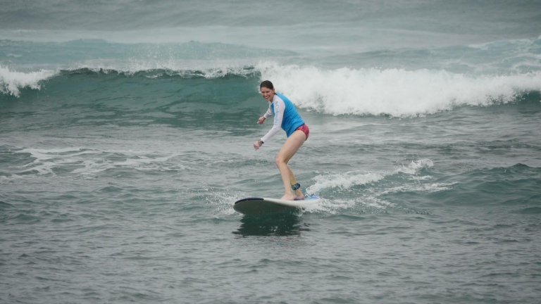 Surfing in Hawaii. Being outside and being active helps me to thrive